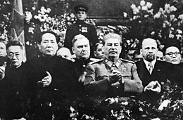 Mao at Stalin's side on a ceremony arranged for Stalin's 70th birthday in Moscow in December 1949. Behind between them is marshal of the Soviet Union Nikolai Bulganin. on the right hand of Stalin is Walter Ulbricht of East Germany and at the edge Mongolia's Yumjaagiin Tsedenbal.