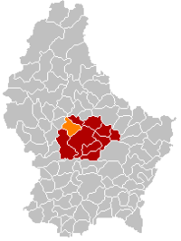 Map of Luxembourg with Bissen highlighted in orange, the district in dark grey, and the canton in dark red