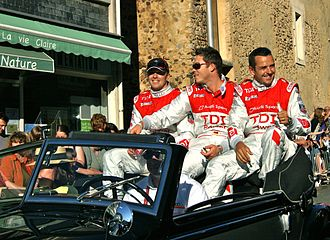 Benoît Tréluyer - Tréluyer with André Lotterer and Marcel Fässler at the 2010 24 Hours of Le Mans drivers' parade