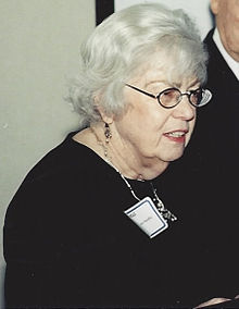 Maryann Mahaffey speaking at 50th anniversary for Henry Messer and Carl House.jpg