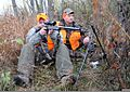 Master Sgt. David Glenn, left, a Soldier with the Wounded Warrior Program, sites in on a deer with the help of Capt. Stephen Spencer, during the Wounded Warrior Hunt on Camp Atterbury Joint Maneuver Training 111115-A-CP678-109.jpg