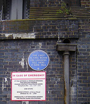 Mile End - V-1 plaque on Grove Road railway bridge (January 2006)