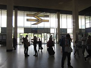 Milton Keynes Central railway station - The station lobby, with the huge National Rail logo above the entrance