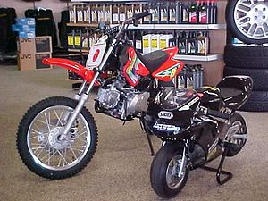 Minibike - A pocket bike (or rather mini-race bike) next to a slightly bigger pitbike, both much smaller than a full size motorcycle