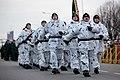 Ministru prezidents Valdis Dombrovskis vēro Nacionālo bruņoto spēku vienību militāro parādi 11.novembra krastmalā (6357911809).jpg