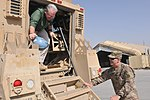Missouri Gov. Jay Nixon is greeted by Brig. Gen. Donnie Walker Jr., commanding general of the 3d Sustainment Command (Expeditionary), as he exits MRAP 140928-A-NY241-167.jpg