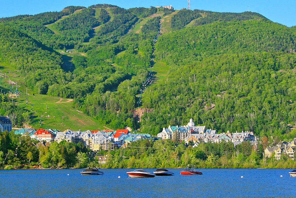 town of Mont-Tremblant at the base of green mountains and waterfront, Quebec province