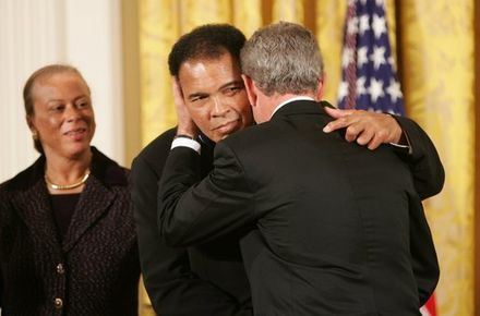 As Mrs. Lonnie Ali looks on, President George W. Bush embraces Muhammad Ali after presenting him with the Presidential Medal of Freedom on November 9, 2005, during ceremonies at the White House. Muhammad Ali and President Bush.jpg