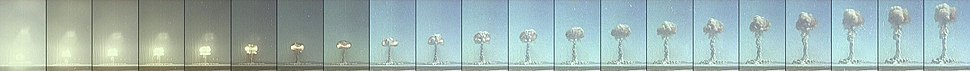 The formation of a mushroom cloud from a nuclear test; Tumbler-Snapper Dog. The streamers of smoke seen to the left of the explosion at detonation are vertical smoke flares used to observe the shockwave from the explosion, and are unrelated to the mushroom cloud.