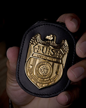 NCIS Badge in hand