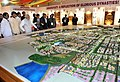 Narendra Modi being briefed about 'Layout Plan of Amaravathi City' - the new Capital of Andhra Pradesh. The Union Minister for Urban Development, Housing and Urban Poverty Alleviation and Parliamentary Affairs.jpg