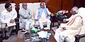 Narendra Singh Tomar and the Minister of State for Labour and Employment (Independent Charge), Shri Bandaru Dattatreya discussing the Clusters selected under National Rurban Mission in Telangana.jpg