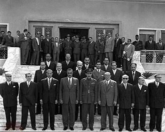 Salah al-Din al-Bitar - Nasser at the gates of the Presidential Palace in Damascus in 1958. Nasser was standing with Syrian and Egyptian cabinet members of the UAR. From left to right; Vice President Hawrani, Abd al-Latif al-Baghdadi, a Vice President, followed by Nasser, Marshal Abd al-Hakim Amer, who became Governor of Syria, and Sabri al-Asali, a Vice President. Then stands Fakhir al-Kayyali, the Minister of Economy. Standing to the far right is Bitar. In the middle row, second from left, is Abd al-Hamid Sarraj, the Minister of Interior