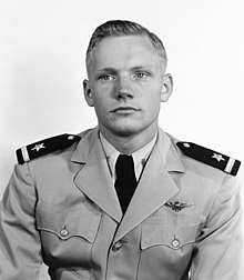 A black-and-white image of a light-skinned man in his early 20s. He is looking off to his right. He has mid-colored hair parted to the right. He wears a light-colored military uniform with an eagle badge on the left chest. His epaulettes are dark and have a light bar and star. He has a white shirt and a dark necktie.
