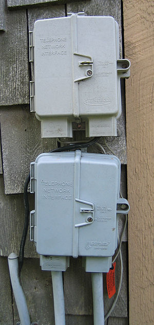 Network interface device - Two simple NIDs, carrying six lines each, on the outside of a building