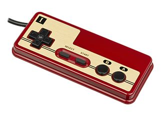 D-pad - A Famicom controller. The D-pad (cross shape on left) first came to prominence on the controller for the Famicom.
