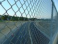 North through fence at SR-265 from Carterville Road bridge, Aug 16.jpg