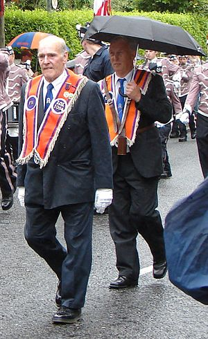 Orange walk - Orangemen in typical marching wear