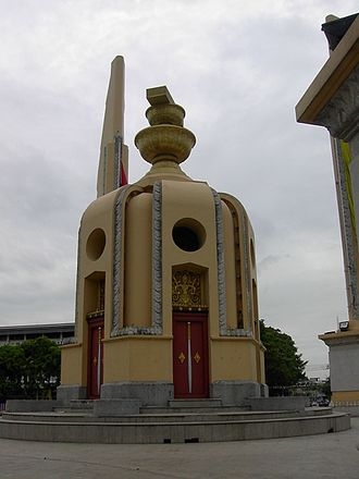 Phan (tray) - A representation of the Thai Constitution of 1932 sits on top of two phans above a round turret at the Democracy Monument in Bangkok.