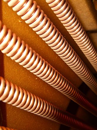 "Wire - Close-up of strings for a piano shows ""overspun"" helical wire wrapping added to main carrier wires"