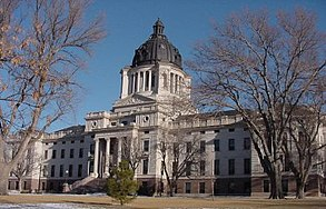 The South Dakota State Capitol building stands near the Missouri River in downtown Pierre. The limestone and white marble building was begun in 1905. Pierre has been South Dakota's capital since 1889. Earlier capitals were Yankton, South Dakota, from 1861 to 1883 and Bismarck, North Dakota, from 1883 to 1889.