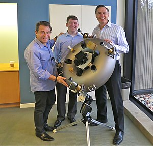 Investment casting - Unveiling the titanium integral space bus satellite by Planetary Resources in February 2014.  The sacrificial mold for the investment casting was 3D-printed with integral cable routing and toroidal propellant tank.  From left: Peter Diamandis, Chris Lewicki, and Steve Jurvetson.