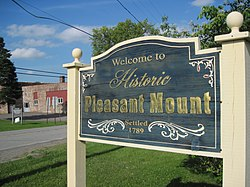 The welcome sign for the Village of Pleasant Mount.