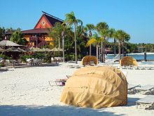 A White Sand Beach Off Of Disney S Polynesian Village Resort With The Tuvalu Longhouse In View