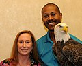 Posing for picture with Bald Eagle. (10594743256).jpg