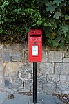 Post box on Village Road, Higher Bebington.jpg