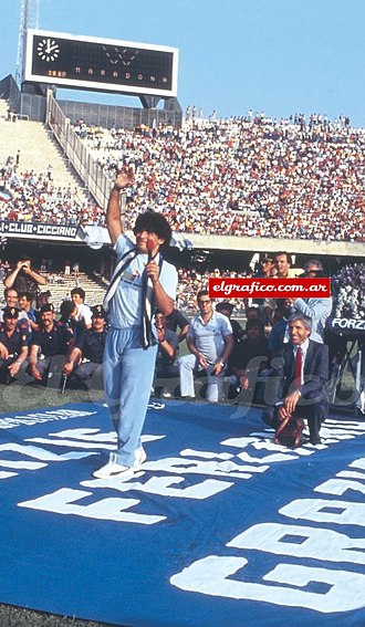 Diego Maradona - Maradona salutes the crowd at San Paolo Stadium during his presentation in Naples, 5 July 1984
