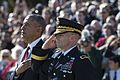 President Barack Obama places his hand over his heart while U.S. Army Maj. Gen. Bradley A. Becker salutes.jpg