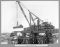 Queensland State Archives 3601 Main bridge erection stage 2 erecting first section of east lower chord of anchor arm Brisbane 8 October 1937.png