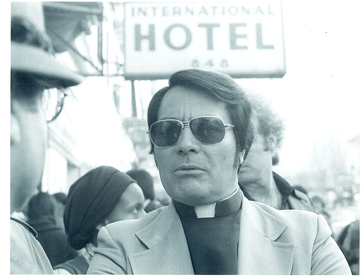 Rev. Jim Jones at an anti-eviction rally Sunday, January 16, 1977 in front of the International Hotel, Kearny and Jackson Streets, San Francisco Photo by Nancy Wong