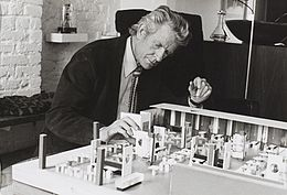 Robin Day with model of John Lewis restaurant, 1973.jpg