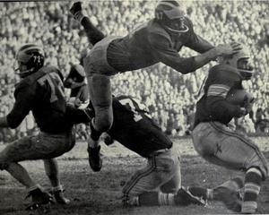 Ron Kramer - Kramer tackling Ohio State's Jim Roseboro, 1956