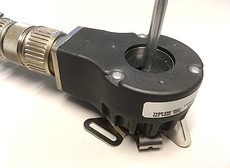 Incremental encoder - A rotary incremental encoder with shaft attached to its thru-bore opening
