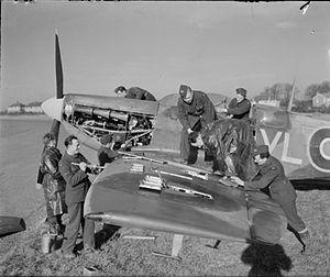No. 322 (Dutch) Squadron RAF - Ground crew service a Spitfire Mark VB of No. 322 (Dutch) Squadron at RAF Hawkinge, February 1944.