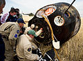 Russian support personnel with the Soyuz TMA-22 capsule shortly after landing.jpg