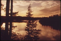 SUNSET OVER SEVENTH LAKE IN THE ADIRONDACK FOREST PRESERVE - NARA - 554760.tif