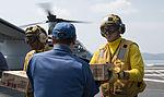Sailors load relief supplies an MV-22B Osprey aircraft. (26474871861).jpg