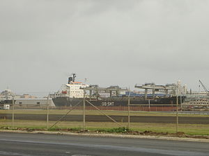 Port of San Juan - A cargo ship unloading in Puerto Nuevo.