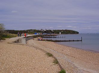St Helens, Isle of Wight - The seafront at St Helens, with the white sea mark of the old church tower in the distance