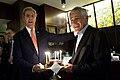Secretary of State John Kerry, left, surprises Secretary of Defense Chuck Hagel with a birthday cake in honor of Hagel's Oct. 4 birthday in Tokyo Oct. 3, 2013 131003-D-BW835-2037.jpg