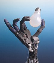 The Shadow robot hand system holding a lightbulb.
