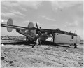 Side view of B-24 resting mainly on the property of the Marine Corps Base having crashed through the guard fence at... - NARA - 295422.tif