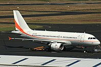 Skytraders Airbus A319 parked at Hobart Airport.jpg