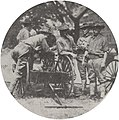 Soldiers Standing by Small Military Cannon, 1918 (4660141034).jpg