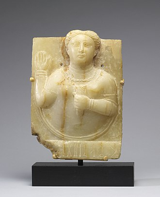 Religion in pre-Islamic Arabia - Sculpture of a Sabaean priestess raising her hand to intercede with the sun goddess on behalf of a donor. Probably first century.
