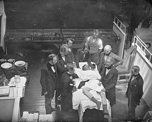 History of general anesthesia - Re-enactment of the first public demonstration of general anesthesia by William T. G. Morton on October 16, 1846 in the Ether Dome at Massachusetts General Hospital, Boston. Surgeons John Collins Warren and Henry Jacob Bigelow are included in this daguerrotype by Southworth & Hawes.